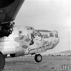 "B-24 at Kingman  ""Mabel's Labels""  Ford B-24L-15-FO Liberator  s/n 44-49854  64th BS, 43rd BG, 5th AF.  Photo taken in April 1947 at Kingman,Arizona.  Artwork painted by S/Sgt. Sarkis Bartigian."