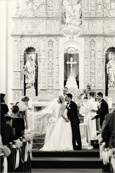 Catholic church wedding ceremony ideas. Tip: Have your maid of honor hold your veil during your kiss for extra cute pictures. #cathedralwedding #ceremony #weddingchicks Captured By: We Heart Photography --- http://www.weddingchicks.com/2014/04/24/timeless-california-wedding/