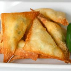 Puffs- wonton wrappers filled with cream cheese, jalapeno, monterey jack, garlic, & green onion
