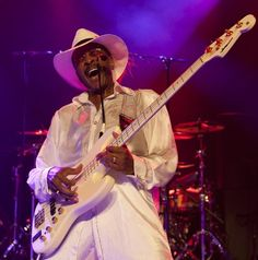 "Larry Graham Bass Player Rock and Roll Hall of Fame as a memeber of Sly and the Family Stone. in 1993. Here Graham is showing a method of playing which has been  useful with some of the better know Bass Players Ever. He's credited with the invention of the slapping technique which expanded the tone of the Bass. Graham considers it be just ""Thumpin and Plucking"""