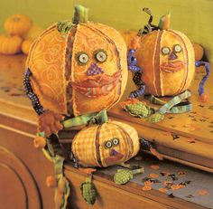 So cute! Pumpkin Heads by designer Jenni Paige.
