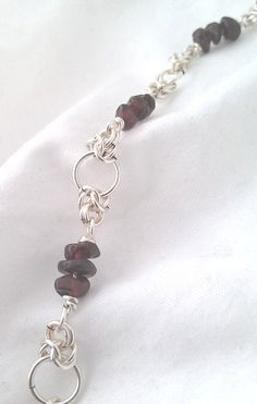 Garnet Chips and Rose Quartz on a sturdy but delicate-looking split Byzantine chain