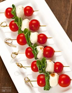 Salad Skewers A simple twist on a traditional Caprese salad, these colorful skewers of ripe cherry tomatoes, fragrant basil and fresh mozzarella are an easy, no-cook appetizer that looks every bit as good as it tastes.Every Every may refer to: Caprese Salad Skewers, Salade Caprese, Fruit Skewers, No Cook Appetizers, Appetizers For Party, Appetizers On Skewers, Italian Food Appetizers, Toothpick Appetizers, Individual Appetizers