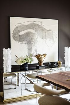 Contemporary dining room | see how this modern mirrored sideboard looks so sleek in this dark walls dining room | http://www.bocadolobo.com/en/ #contemporarydecor #moderninteriordesign