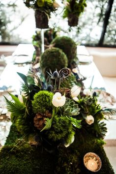 Part of 2nd round table centerpiece--moss base with mercury glass votives