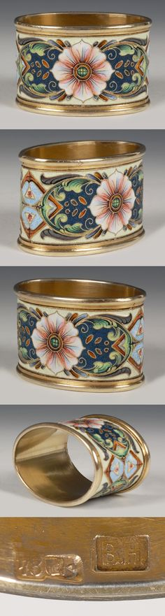 A Russian silver gilt and shaded cloisonne enamel napkin ring, Vasilly Naumov, Moscow, circa 1908-1917. The oval ring decorated with scrolling floral and foliate motifs against a cream ground.