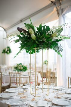 Gatsby inspired, art deco event decor. Tropical centerpieces. White protea, white dendrobium orchids.