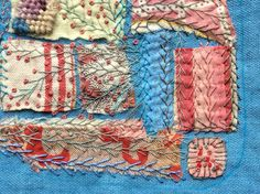 Hand stitching . Woad dyed background and scraps. Ann Stephens