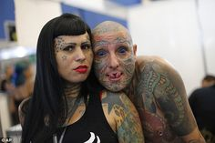 Totolinha, left, and Rato pose for a photo during Rio Tattoo Week in Rio de Janeiro, Brazil