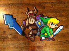 Here is one of my more recent creations, toon link with phantom warrior zelda It is made from perler beads and has 8764 beads in all. I created the pixel art this is from so if anyone wants it, jus. Perler Beads, Perler Bead Art, Fuse Beads, The Legend Of Zelda, Pixel Art Objet, Stitch Games, Nerd Crafts, Hama Beads Design, Beaded Cross