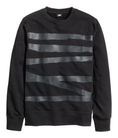 Black, crew-neck sweatshirt with a glossy, printed, tone-on-tone design at front. Wide ribbing at cuffs and hem. | H&M For Men