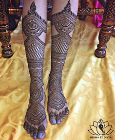 Floral Leaf Feet Mehndi Design A full leg mehndi design with basic floral, leaf and spiral motifs looks amazing. Source-Henna by D