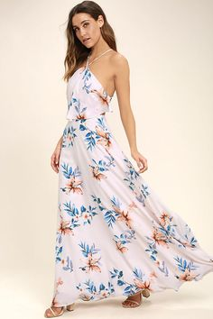 Overlook the islands in the Peninsula Light Peach Floral Print Maxi Dress! Lightweight woven poly, in a light peach and blue floral print, shapes a modified halter neckline with skinny straps that crisscross and tie above an elasticized, open back. Tiered bodice tops a full maxi skirt. Hidden back zipper.