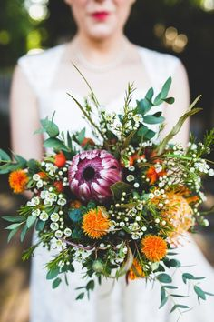 Wax Flower Bouquet Protea Orange Purple Autumn Kentish Village Hall Wedding - I like how this bouquet fans out. Also all the unique types of flowers Protea Wedding, Fall Wedding Bouquets, Fall Wedding Flowers, Bridal Flowers, Floral Wedding, Bridal Bouquets, Hops Wedding, Autumn Flowers, Fall Bouquets