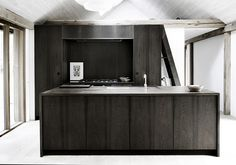 Luxe Nordic cabin with kitchen by Københavns Møbelsnedkeri of Denmark | Remodelista  The backsplash is fumed oak with a lacquer and oil finish