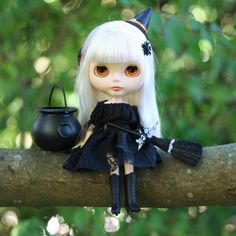 This handmade blouse and skirt make a festive witch costume for your Blythe, Pullip or other playscale doll's Halloween wardrobe. The outfit features a black blouse and a black skirt with sheer cobweb