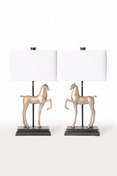 Horse lamps on top of bookshelves leading into room.  22H; 9 x 5 base.  scale might be a bit large, but if Lola/Ruby like it, let's squeeze it in.  shades to be a solid linen.  maybe a green gray?