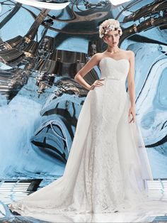 """Wedding gown by Helen Miller """"Orion"""" is a beautiful lace mermaid wedding gown with a detachable tulle skirt."""