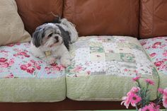 Perfect for the shabby chic look.. but ALSO would be nice for outdoor furniture, or a sleeping porch!!  Tutorial to use quilts to slip cover cushions.... for your #cottage couch