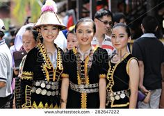 Kota Kinabalu, Malaysia - May 30, 2015: Girls of various Dusun ethnic in their traditional costume pose for the camera during the Sabah State Harvest festival celeberation in Kota Kinabalu, Sabah.