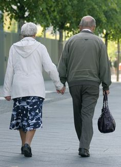 Holding-hands, Gotta love a man who carries your purse for you. Awww!!