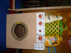 "Laundro mat prop box. After reading ""knuffle Bunny A cautionary tale"" by Mo Willems children will play doing laundry at the dramatic play area."