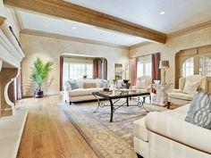 Such an inviting living room! Cozy and chic.  (9002 Douglas Avenue, Preston Hollow - Dallas, Texas)