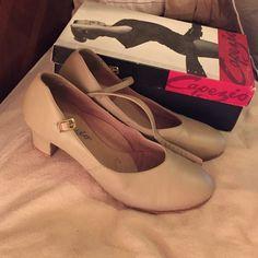Capezio Tan Character Dance Shoes Size 9Wide character dance shoes in fairly good condition. Comes in original box. 2inch heel Capezio Shoes Heels