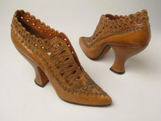 lady's leather shoes with 'eyelet' cutwork, and embroidered stitching on the toes & along the sides. (Circa 1910-1920s)