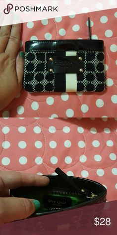 Kate Spade black &white wallet with great pattern! White and black outside with fun designs. Inside lining is lime green. Zipper to hold cards, etc it is about 5 inches or so long kate spade Bags Wallets