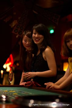Friends enjoying the roulette table at Charlie's bar Madame Burlesque party May 12th in Shanghai/China