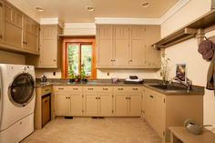 The laundry room serves, too, as a mudroom, with plenty of storage and a practical linoleum floor.