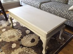Homemade french country white chalk paint on coffee table with carved ball and claw footings