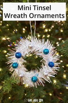 Make these DIY Tinsel Mini Wreath Ornaments as a modern twist on the usual mini wreath ornaments you see. Shiny and glittery a beautiful easy craft to DIY this Holiday season. Great as gifts or even tied onto a beautifully wrapped gift. Silver Christmas Tree, Diy Christmas Ornaments, How To Make Ornaments, Christmas Wreaths, Christmas Decorations, Holiday Decor, Hanging Ornaments, Seasonal Decor, Holiday Crafts