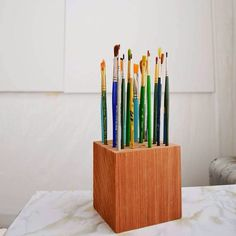 A pretty way to keep your paintbrushes in good shape. I smell a DIY....