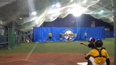 Don Hays working with catchers and the High School Winter Training Program - teaching how to help a pitcher command his fastball low by making adjustments with the catchers target according to the types of misses the pitcher is making; January 2014
