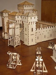 Laser cut castle with working catapult and trebuchet