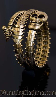 Skeleton Bracelet - 'looks like a spine with a skull on the end' - 'designed exlusively for DraculaClothing by Truls Stokka.'  #jewelry #bracelets #jewellery