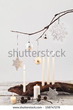 Christmas candles and handmade decorations on white  - stock photo - DIY Article