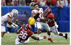 NEW ORLEANS, LA - JANUARY 01:  Jalin Marshall #17 of the Ohio State Buckeyes gets tackled Reggie Ragland #19 of the Alabama Crimson Tide during the All State Sugar Bowl at the Mercedes-Benz Superdome on January 1, 2015 in New Orleans, Louisiana.  (Photo by Streeter Lecka/Getty Images)