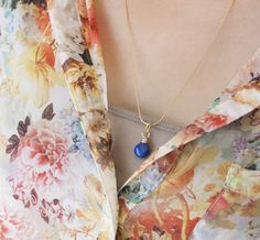 DIY wire wrapped pendant with instructions on how to wire wrap a briolette