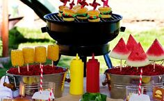 Food ideas - corn cobs and watermelons on skewers in buckets
