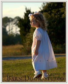 LOVE, LOVE, LOVE this little girl!  White dress at Sea Islands Yacht Club in Rockville, on Wadmalaw Island.  www.barndoorstudiosc.com
