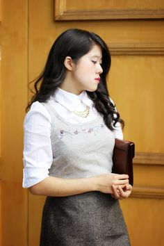 Love the detailing of the sweater vest and thrifted gold necklace. The thrifted tan leather clutch is a plus!  Personal style, office appropriate, outfit inspiration, daily casual, Jcrew, thrifted fashion,