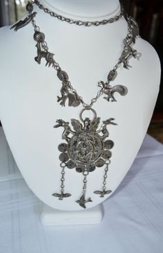 Antique Sterling Silver Guatemalan Chachal Coin and Milagro Necklace 1800's from Okee's Secret Room on Ruby Lane