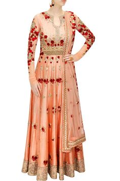 This floor length rawsilk flared anarkali is featuring in maroon and beige floral motifs embroidered all over it. It has silver applique work all around the he