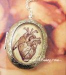 Medaglione apribile porta foto con cuore anatomico