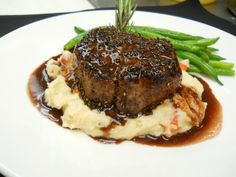 Crusted Petite Filet, served over Lobster Mashed Potatoes, Green Beans and finished with a Merlot Reduction.Pepper Crusted Petite Filet, served over Lobster Mashed Potatoes, Green Beans and finished with a Merlot Reduction. Gourmet Recipes, Beef Recipes, Dinner Recipes, Cooking Recipes, Gourmet Desserts, Dinner Ideas, Beef Dishes, Food Dishes, Steak And Mashed Potatoes