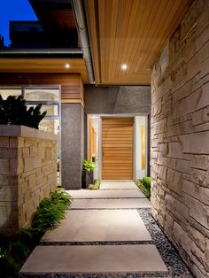 Front door that mimics the entry ceiling.