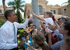 President Barack Obama high fives a young boy outside an event in Palm Beach Garden, Florida, April First Black President, Former President, Obama President, Black Presidents, Greatest Presidents, Barack Obama Family, High Five, Political News, Michelle Obama